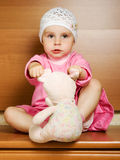 Little girl with plush toy. Royalty Free Stock Photography