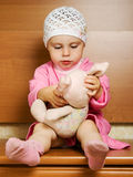 Little girl with plush toy. Royalty Free Stock Photos