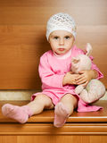 Little girl with plush toy. Royalty Free Stock Images