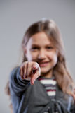 Little girl point ing out her finger Stock Images