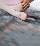 Little girl with pointe shoes Stock Photography