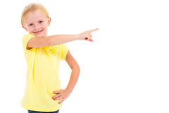 Little girl pointing. Cute little girl pointing at empty copyspace on white Stock Images