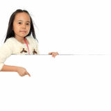 Little girl pointing blank board. Royalty Free Stock Image