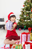 Little girl pointing Christmas present Royalty Free Stock Photography
