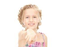 Little girl pointing her finger Stock Photo