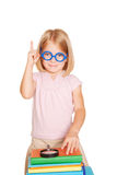 Little girl  pointing index finger up. Royalty Free Stock Photo
