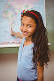 Little girl pointing at map in classroom Stock Photography