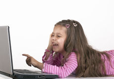 Little Girl pointing at monitor Royalty Free Stock Images