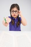 Little girl pointing pencil and talking. Stock Images