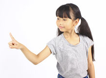 Little girl pointing up with her finger Royalty Free Stock Photography