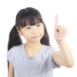 Little girl pointing up with her finger Royalty Free Stock Photos