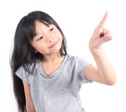 Little girl pointing up with her finger. On white background Royalty Free Stock Image