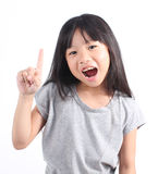 Little girl pointing up with her finger. On white background Royalty Free Stock Photo