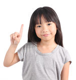 Little girl pointing up with her finger Stock Photo