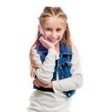Little girl pointing upwards Stock Photos