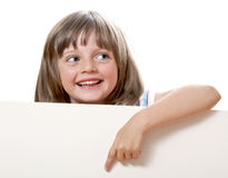 Little girl pointing on  white board Royalty Free Stock Photos