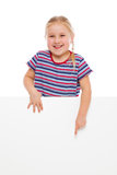 Little girl pointing at whiteboard. Stock Images