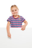 Little girl pointing at whiteboard. Stock Photos