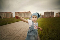 Little girl points to the side Royalty Free Stock Images