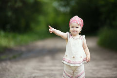 Little girl points up Stock Images