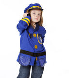 Little Girl in Police Costume. Isolated on white Stock Image