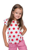 Little girl in a polka dot blouse Royalty Free Stock Photos