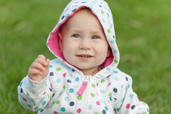 Little girl in the polka dot jacket Stock Photo