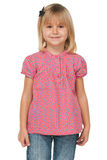 Little girl in a polka dot shirt Royalty Free Stock Photography