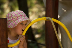 Little girl is pondering over Royalty Free Stock Photo