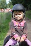 Little girl on pony stock photography