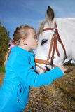 Little girl with pony. Portrait of a little happy girl with a pony Royalty Free Stock Photography