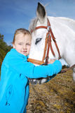 Little girl with pony royalty free stock photo