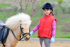 Little girl and pony Stock Images