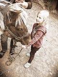 Little girl and pony Stock Photo