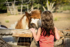Little girl with pony on the ranch Royalty Free Stock Photos