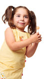 Little girl in ponytails holding a lollipop Royalty Free Stock Photos