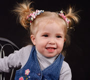 Little girl with ponytails Stock Photo
