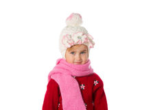 Little girl with ponytails in a warm hat and red sweater  on a w Stock Photography