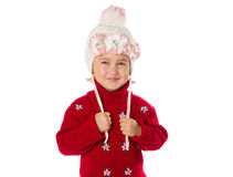 Little girl with ponytails in a warm hat and red sweater  on a w Stock Images