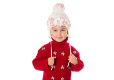 Little girl with ponytails in a warm hat and red sweater  on a w Stock Photos