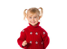 Little girl with ponytails in a warm red sweater on a white back Royalty Free Stock Image