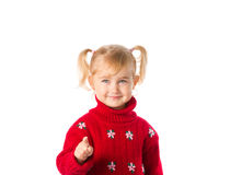 Little girl with ponytails in a warm red sweater on a white back Royalty Free Stock Photo