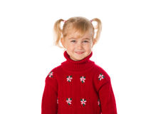Little girl with ponytails in a warm red sweater on a white back Stock Photos