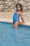 Little girl on a pool Royalty Free Stock Image