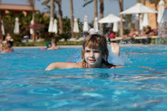 Little girl in pool Stock Photos