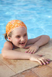 Little girl in pool. Stock Photos