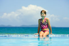 Little Girl in pool royalty free stock image