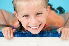 Little girl in the pool Royalty Free Stock Photography
