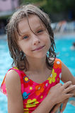 Little girl in the pool Stock Images