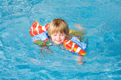 Little girl in the  pool. Little girl in the swimming pool Royalty Free Stock Images